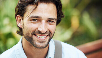 Man with healthy smile outdoors